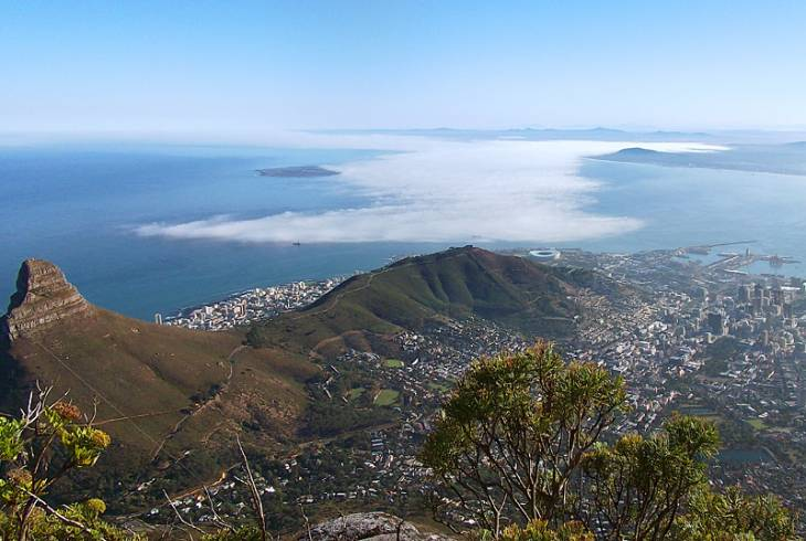 A view from the top of Table Mountain showing Lion's Head (left), Robben Island and Cape Town Stadium