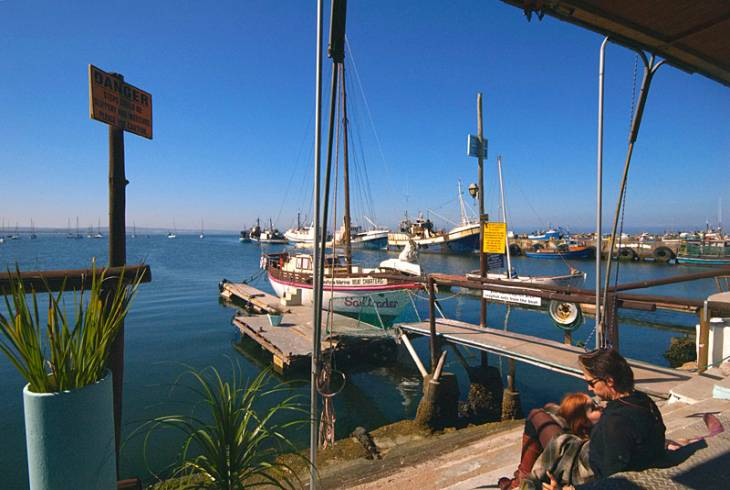 The Slipway Waterfront Restaurant nestles at the edge of the wind free, tranquil waters of Saldanha Bay harbour