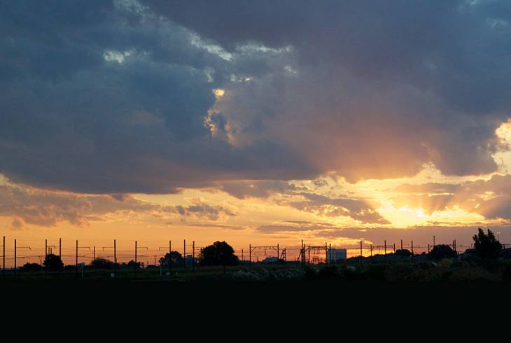 Sun sets behind the Germiston railyard