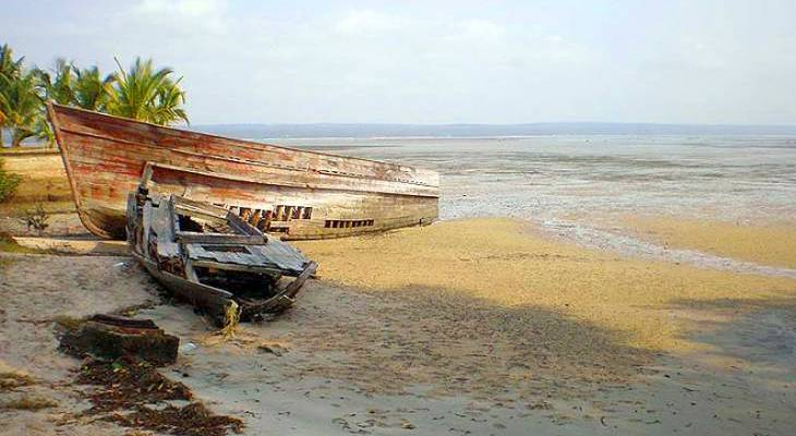 Boats beached on the sand in Inhambane City.